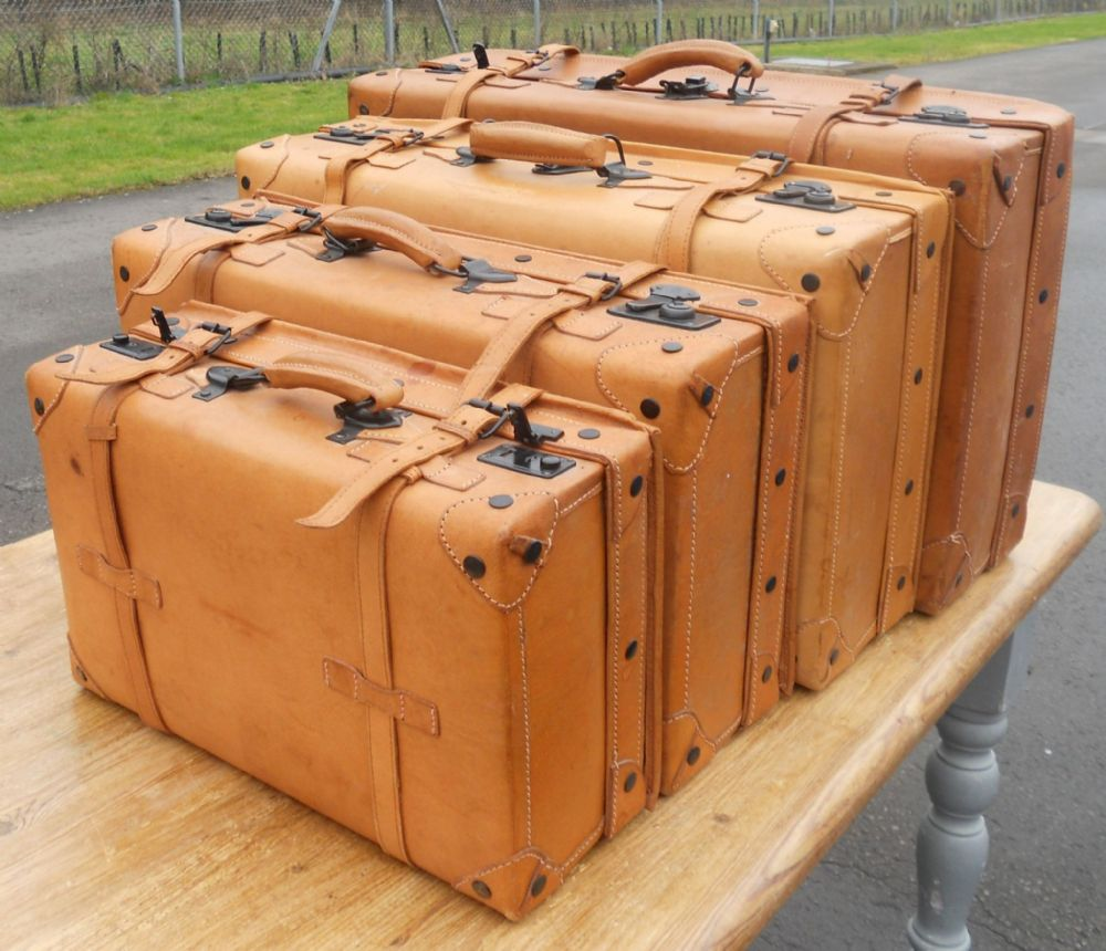 Set of Four Leather Suitcases by Giovanni